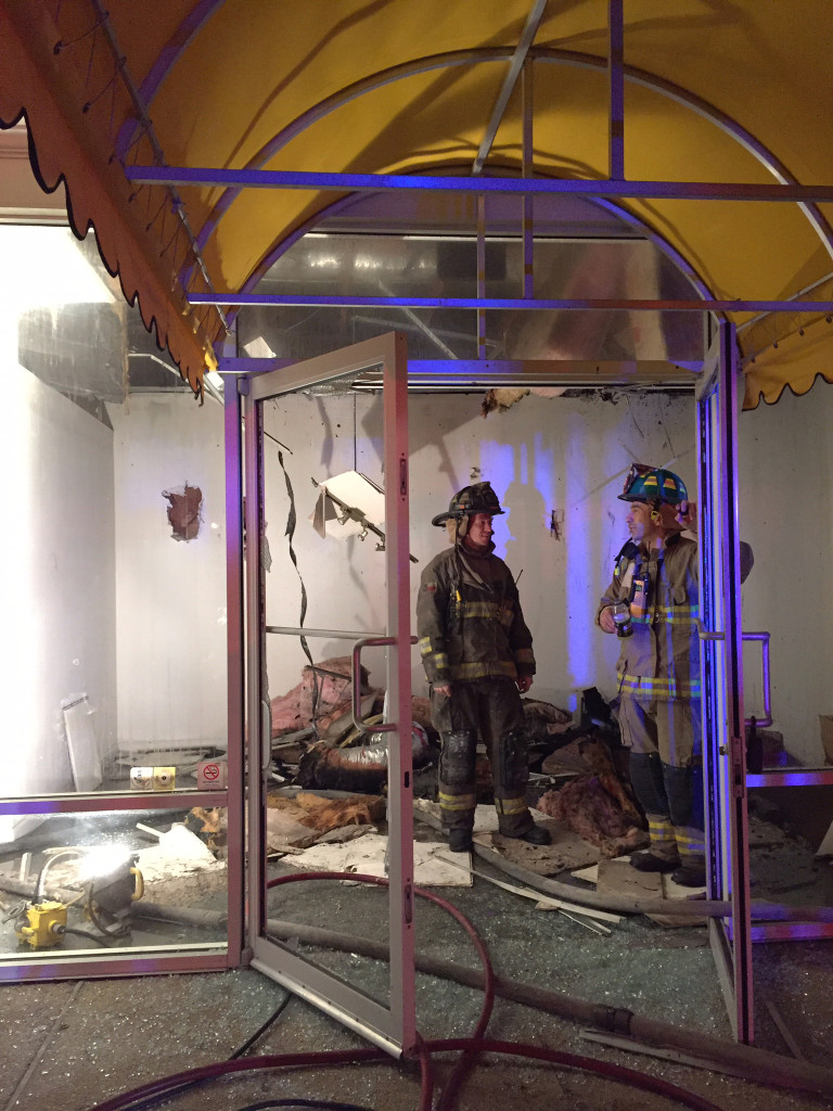 Firefighters work at the former CycleHub space next door to Lyn Belisle Studio