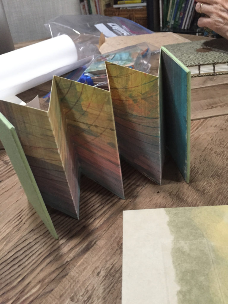 Handpainted accordion book by Mary Ann Johnson