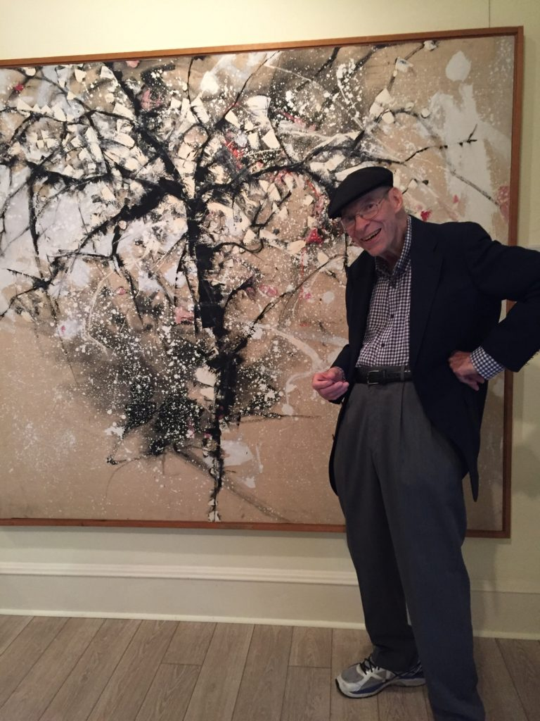Art Professor Bill Bristow with his 1961 painting, Cherry Tree in Snow,